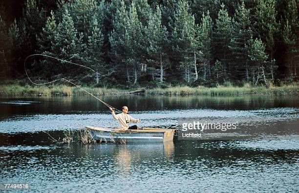 HRH The Duke of Edinburgh fishing for trout on a loch on the Estate at Balmoral Castle Scotland during the Royal Family's annual summer holiday in...