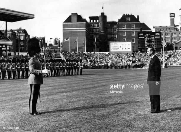 HRH the Duke of Edinburgh is saluted by an officer of the Welsh Guards before the inspection of the Guard of Honour Wales circa 1955