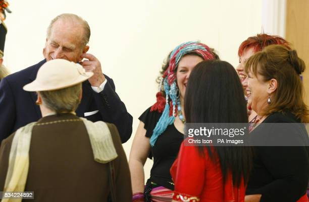 The Duke of Edinburgh jokes with the Eastern dance group during a visit to St Thomas Community Primary School in Swansea Picture date Friday March 7...