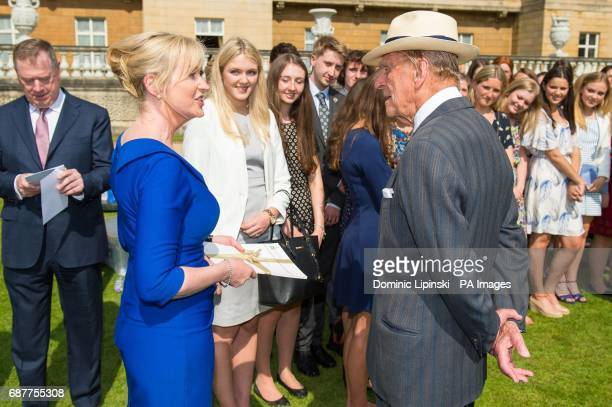The Duke of Edinburgh meets Carol Kirkwood at the Duke of Edinburgh's Award gold award presentations at Buckingham Palace London