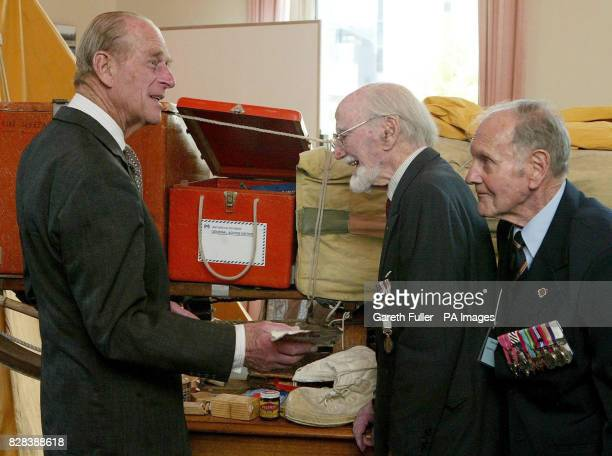 The Duke of Edinburgh meets former polar explorers Dr Philip Law and Squadron Leader Douglas Leckie at the Royal Society Building in Melbourne...
