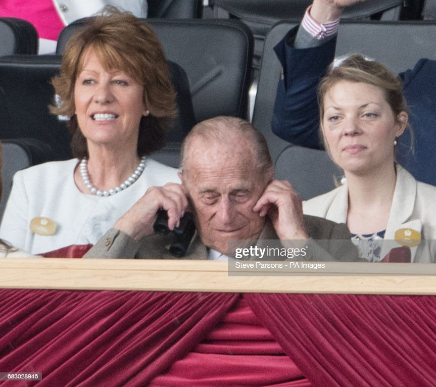 The Duke of Edinburgh puts his fingers in his ears to protect against the loud noise of the canons from the King's Troop Royal Horse Artillery at the Royal Windsor Horse Show, which is held in the grounds of Windsor Castle in Berkshire.