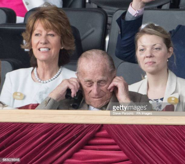 The Duke of Edinburgh puts his fingers in his ears to protect against the loud noise of the canons from the King's Troop Royal Horse Artillery at the...