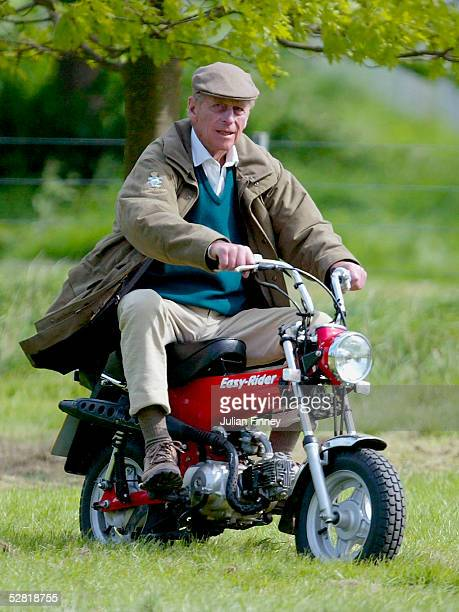 The Duke of Edinburgh rides on his mini motorbike during the Royal Windsor Horse Show at Home Park Windsor Castle on May 13 2005 in Windsor England