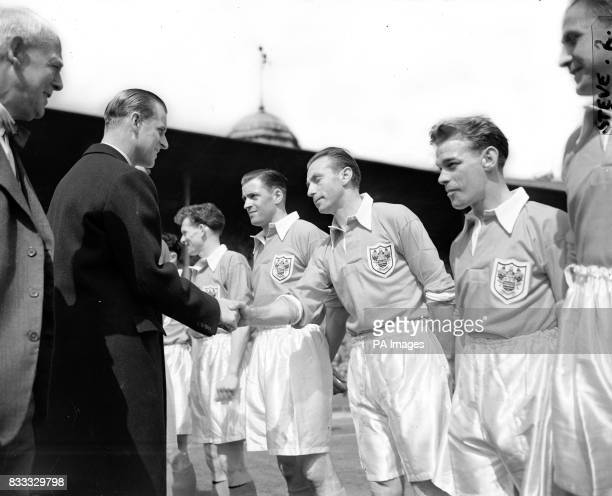 The Duke of Edinburgh shakes hands with Blackpool's Stanley Matthews before kick off in the Cup Final