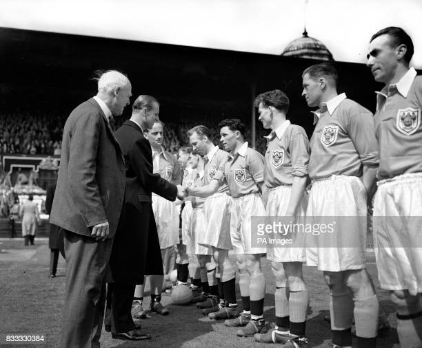 The Duke of Edinburgh shakes hands with Blackpool's William Perry before kick off in the Cup Final