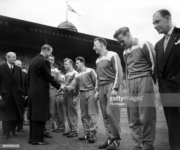 The Duke of Edinburgh shakes hands with the Man City team before the kick off of the Cup Final at Wembley The Queen and Princess Margaret also...