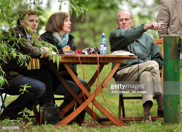 The Duke of Edinburgh sits with other fence judges during the carriage driving competition at the Royal Windsor Horse show in the private grounds of...