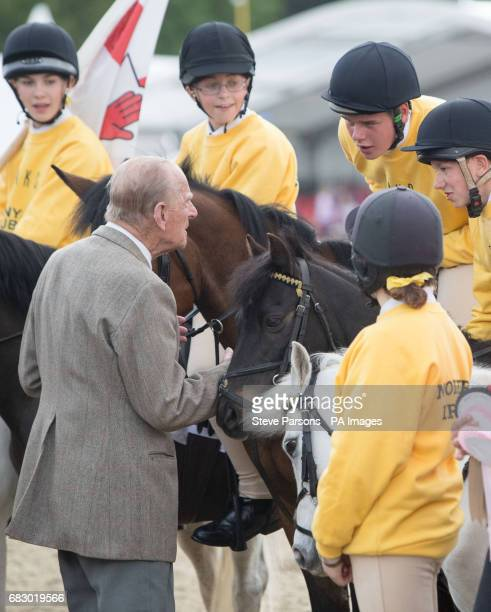 The Duke of Edinburgh talks to team Northern Ireland who took part in the DAKS Pony Club Mounted Games at the Royal Windsor Horse Show which is held...