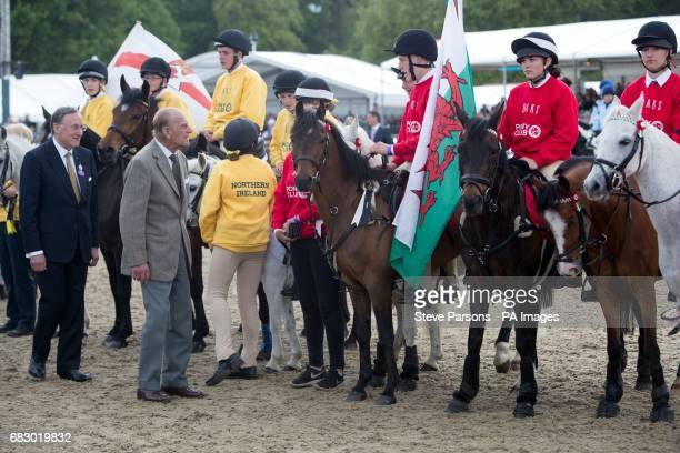The Duke of Edinburgh talks to team Wales who took part in the DAKS Pony Club Mounted Games at the Royal Windsor Horse Show which is held in the...