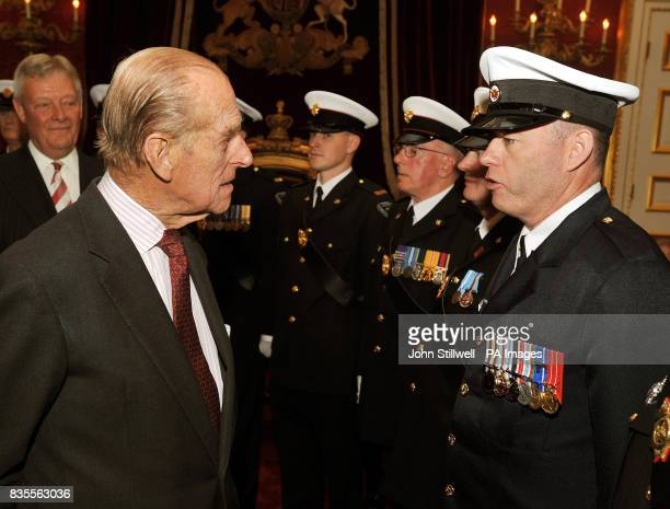 The Duke of Edinburgh talks with Scott Harris from Canada during a reception for the Corps of Commissionaires in honour of their 150th anniversary at...