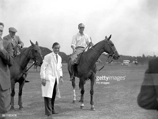 The Duke of Edinburgh umpires a polo match at Smith's Lawn Windsor Great Park two weeks after breaking his ankle playing the sport