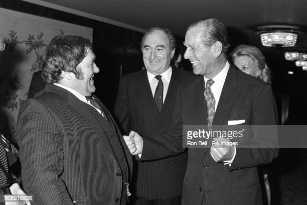 The Duke of Edinburgh uses burly comedian Les Dawson as a punch bag during the National Sponsored Sports Luncheon at Grosvenor House Hotel London...