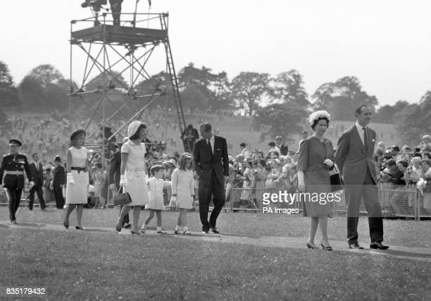 The Duke of Edinburgh walks and talks with Caroline and John children of Jacqueline Kennedy left as they leave after the inauguration by Queen...
