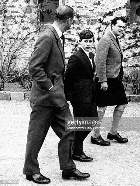 The Duke of Edinburgh walks with his son and Captain Iain Tennant in front of Gordonstoun Prince Charles� exclusive public school Heir to the throne...