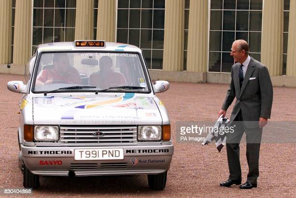 The Duke of Edinburgh waves off a London Taxi from the Quadrangle of Buckingham Palace as the taxi attempts a record breaking global roundtrip The...
