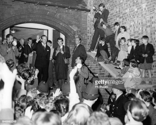 The Duke of Edinburgh waves to the crowd waiting for him as he leaves the Harrow Club in Bard Road Notting Hill London The club entirely supported by...
