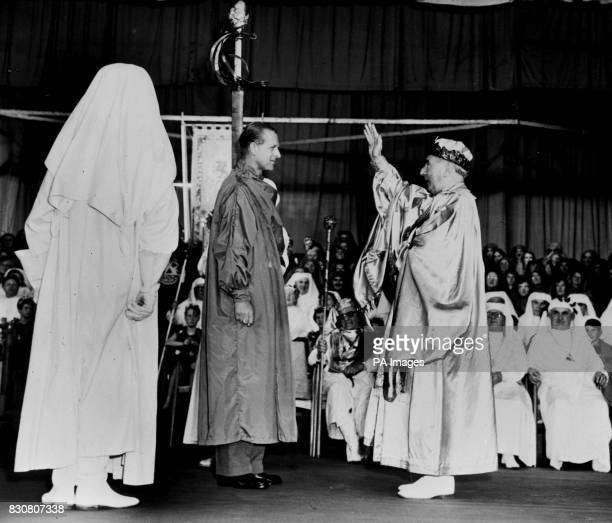 The Duke of Edinburgh wearing the green robes of a bard is given his Welsh bardic title 'Philip Meirionnydd' by the Archdruid of Wales Mr Edgar...