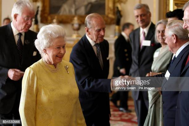 The Duke of Edinburgh who celebrates his 87th birthday today greets the former governor of the Bank of England Sir Edward George as he attends a...