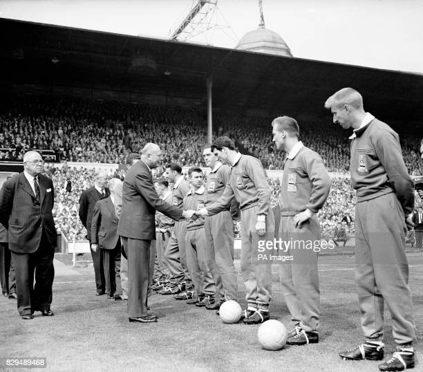 HRH The Duke of Gloucester shakes hands with Blackburn Rovers' Derek Dougan as he is introduced to the players before the match by Rovers captain...