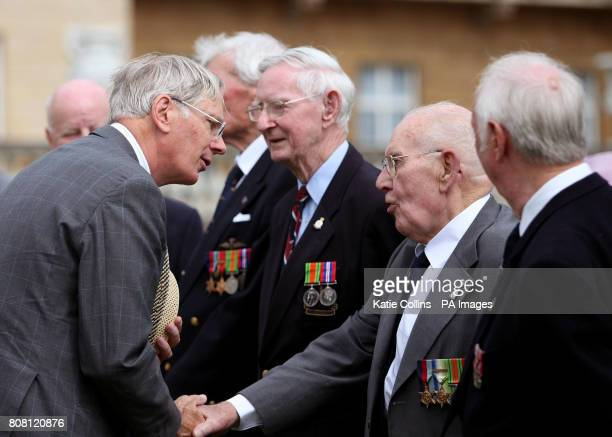 The Duke of Gloucester speaks to members of the Gliders Association Guinea Pig club at the Not Forgotten Association Garden Party at Buckingham Palace