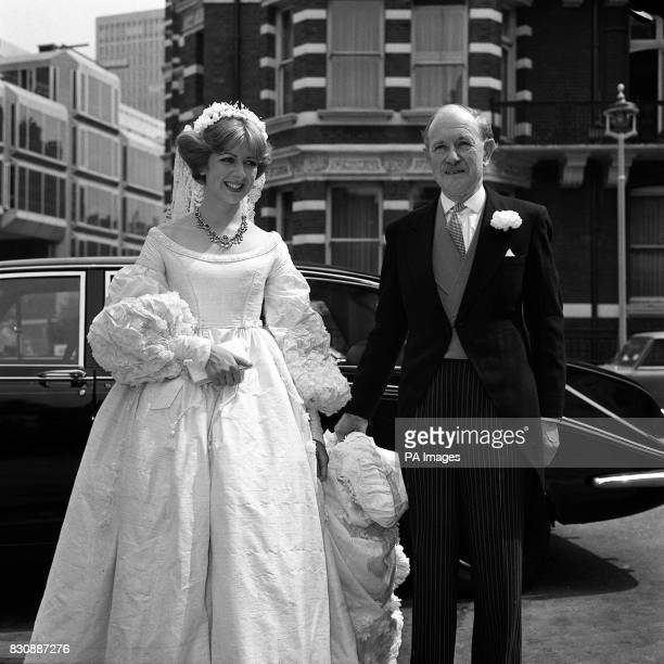 The Duke of Norfolk hereditary Earl Marshal of England holds the bride's train as he arrives with his 24yearold daughter Lady Marsha Fitzalan Howard...