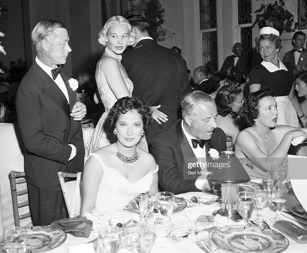 The Duke of Windsor and <a gi-track='captionPersonalityLinkClicked' href=/galleries/search?phrase=C.Z.+Guest&family=editorial&specificpeople=216140 ng-click='$event.stopPropagation()'>C.Z. Guest</a> standing while <a gi-track='captionPersonalityLinkClicked' href=/galleries/search?phrase=Merle+Oberon&family=editorial&specificpeople=208700 ng-click='$event.stopPropagation()'>Merle Oberon</a> and Mrs Stephen Sanford are seated at a table at the Polo Ball, La Coquille restaurant, Boca Raton, Florida, c1956