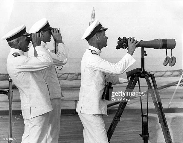The Duke of Windsor as Edward Prince of Wales on board HMS Queen Elizabeth during fleet exercises in the Mediterranean In the centre is his younger...