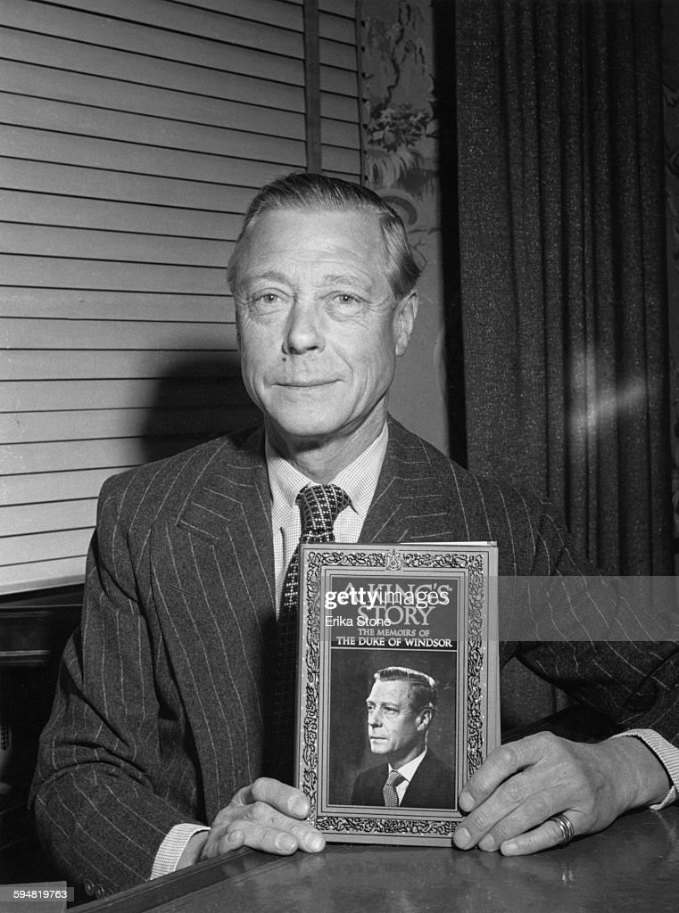 The Duke of Windsor (1894 - 1972), formerly King Edward VIII, with his memoirs, entitled 'A King's Story: The Memoirs of the Duke of Windsor', circa 1951.