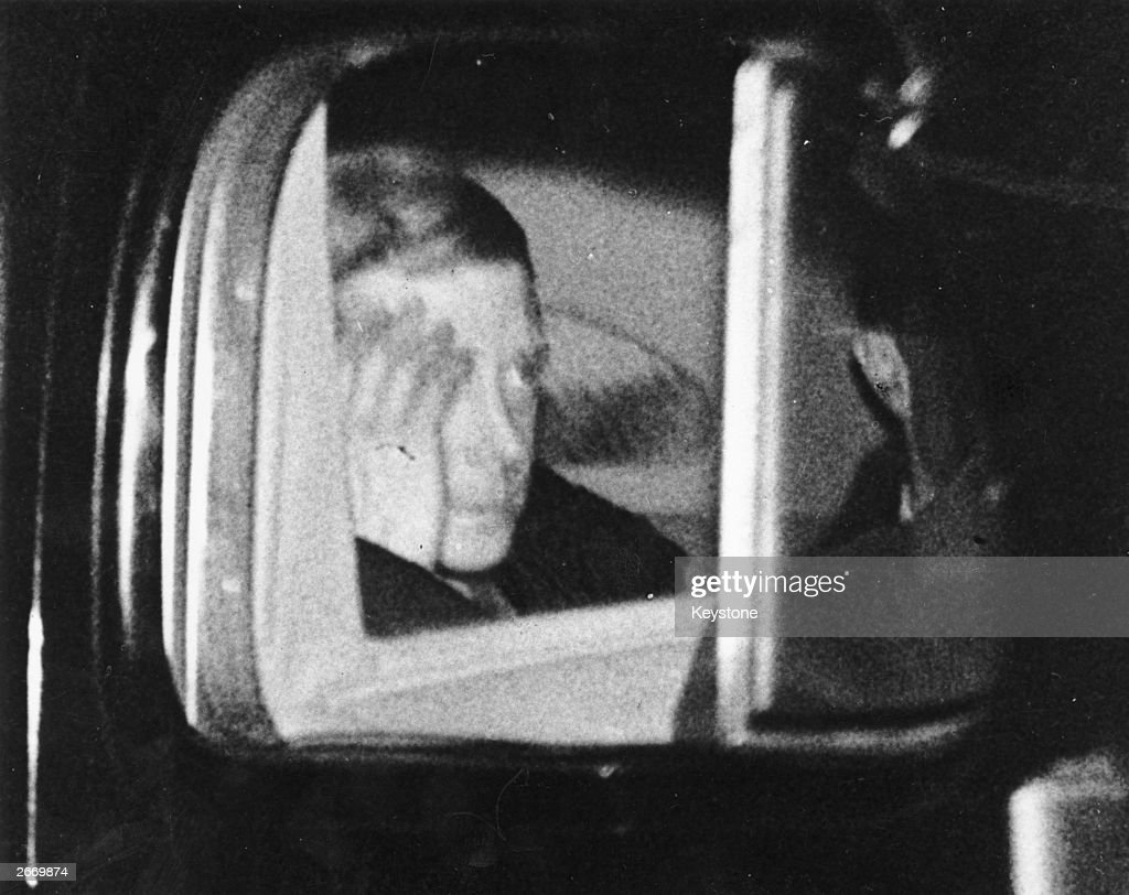The Duke of Windsor hides his face leaving Windsor Castle in Berkshire after making his abdication speech to the nation