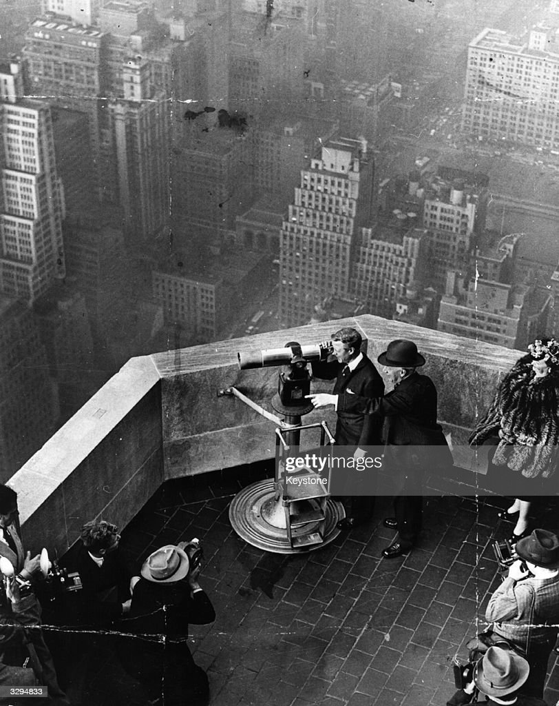 The Duke of Windsor, (1894 - 1972), on the rooftop of the Empire State building in New York, with American Democratic politician <a gi-track='captionPersonalityLinkClicked' href=/galleries/search?phrase=Al+Smith+-+Politician+-+Born+1873&family=editorial&specificpeople=90242 ng-click='$event.stopPropagation()'>Al Smith</a>, (1873 - 1944), a former Governor of New York State and the defeated candidate in the presidential election of 1928. Smith was the first catholic to run for office of President.