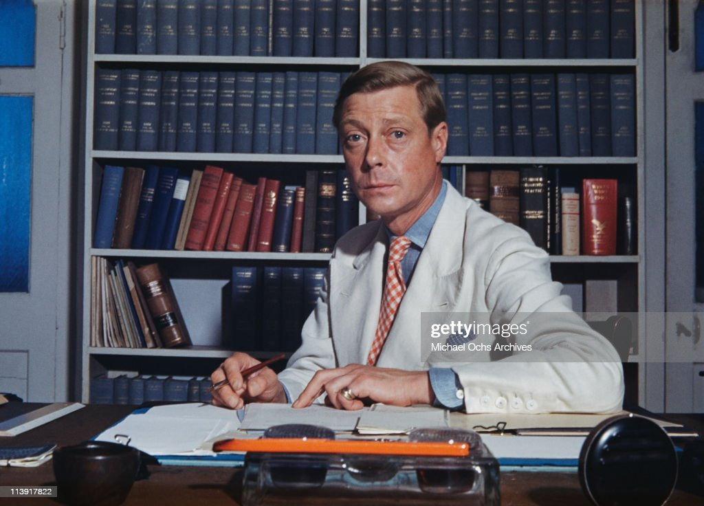 The Duke of Windsor (1894-1972) sitting at a desk, which is strewn with books and paperwork in Goverment House in Nassau, the Bahamas, circa 1942. The Duke of Windsor served as Governor of the Bahamas from 1940 to 1945.