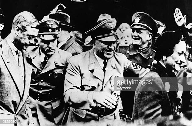 The Duke of Windsor who reigned as King Edward VIII in 1936 in Germany with Dr Robert Ley leader of the German Labour Front With them is Wallis...