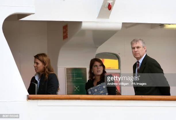 The Duke of York and his daughters Princess Eugenie and Princess Beatrice board the Hebridean Princess in Stornoway as they begin a holiday with...