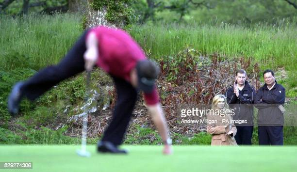 The Duke of York and the chairman of Loch Lomond golf club Lyle Anderson watch Scotland's Colin Montgomerie on the fifteenth green during the first...
