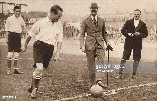 'The Duke of York kicking off a charity football match between Tottenham Hotspurs and Corinthians' c1921 From Our King Queen and the Royal Princesses...