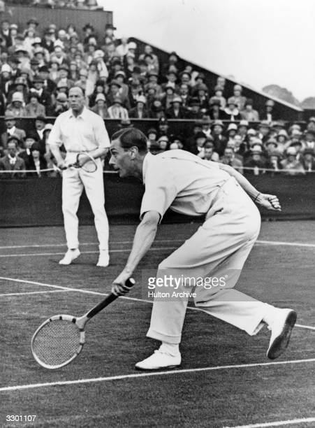 The Duke of York later George VI playing in a doubles match at Wimbledon with his partner Wing Commander Louis Greig The Duke was an ace tennis player