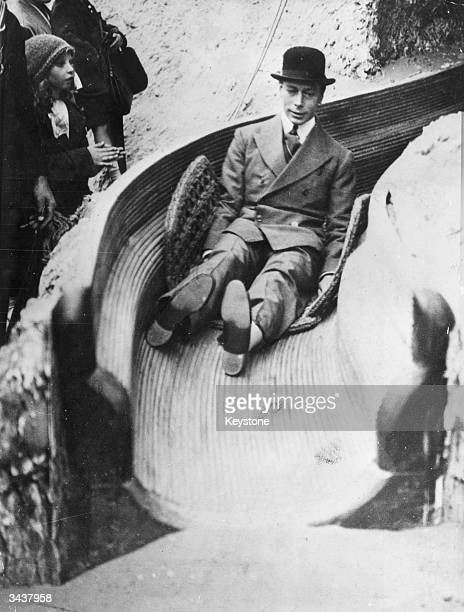 The Duke of York later King George VI of Great Britain on a slide at the Wembley exhibition