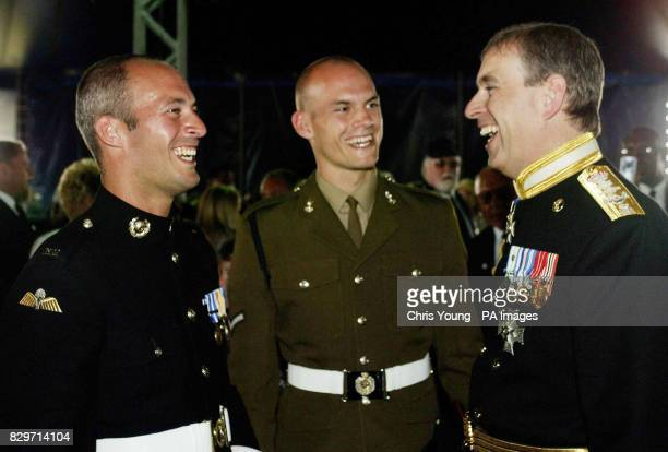 The Duke of York shares a joke with two of three brothers from Bournemouth who are direct descendants of Lord Nelson Royal Marine Commando Craig...
