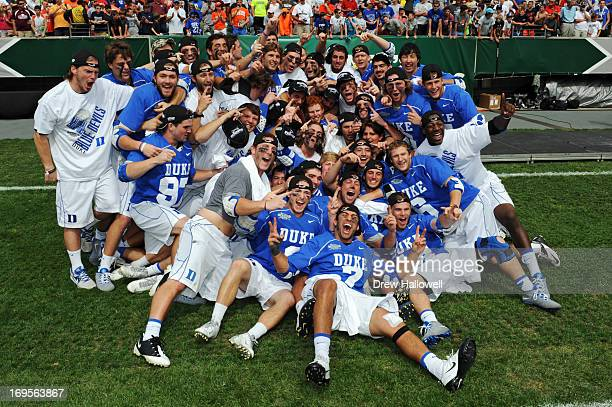 The Duke University Blue Devils celebrate after defeating Syracuse University Orange 1610 for the 2013 NCAA Division I Men's Lacrosse Championship at...