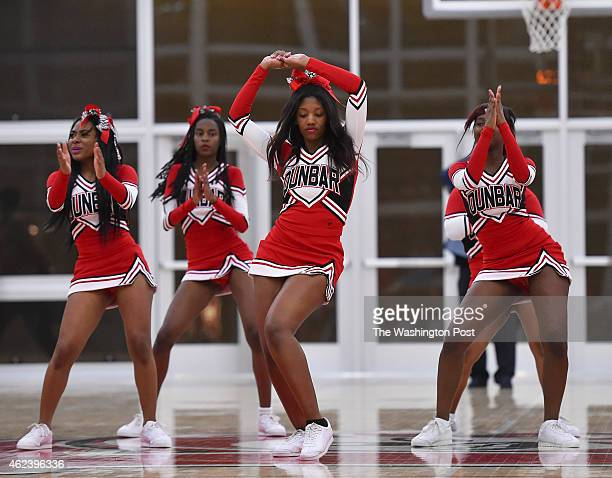 The Dunbar cheerleaders perform during halftime in a boy's basketball game between Eastern High School and Dunbar High School at Dunbar High on...