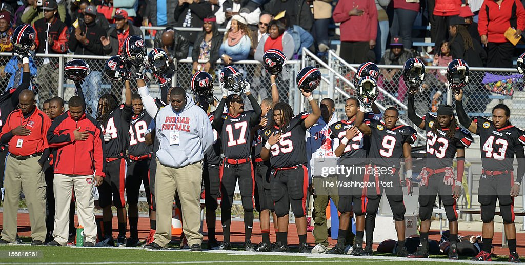 The Dunbar team is shown during the National Anthem as Dunbar defeats Anacostia 12 - 8 in the Turkey Bowl at Eastern High School in Washington DC, November 22, 2012 .