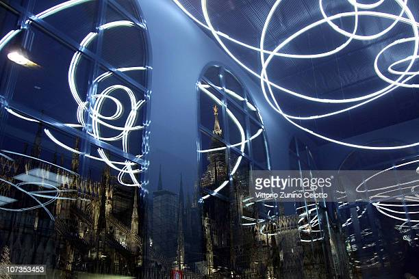 The Duomo of Milan and 'Concetto Spaziale' by Lucio Fontana are reflected on a window during the Museo Del Novecento Opening on December 6 2010 in...
