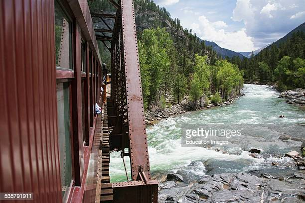 The Durango and Silverton Narrow Gauge Railroad Steam Engine travels along Animas River Colorado