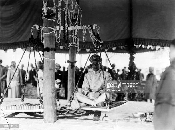 The Durbar celebrations at Alwar The Maharajah of Alwar being weighed against silver on scales This resulted in a large sum being given to the poor