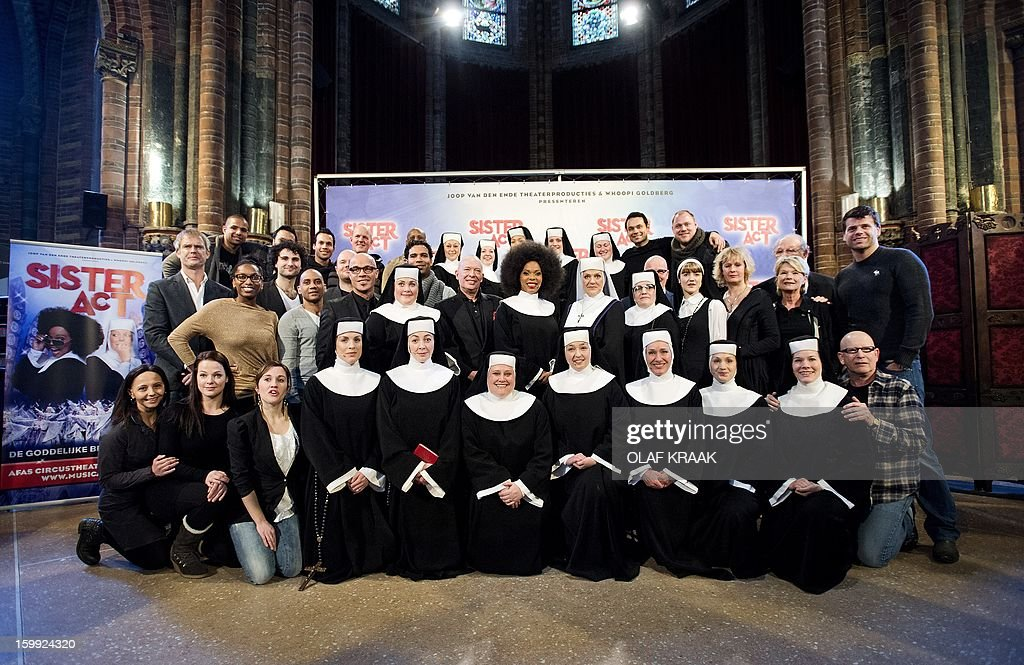 The Dutch cast of the musical 'Sister Act' poses during the press presentation at the Vondel Church in Amsterdam on January 23, 2013. The musical will premiere at the AFAS Circus Theatre in The Hague on March 3, 2013. AFP PHOTO / ANP - OLAF KRAAK netherlands out