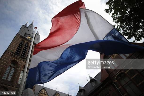 The Dutch flag flies at half mast outside Saint Vitus church during a special mas in memory of the victims of Malaysia Airlines flight MH17 on July...