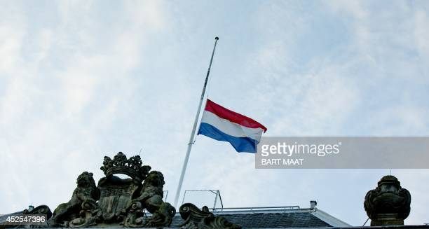 The Dutch flag flies half mast on the building of the Ministry of Defence in The Hague the Netherlands on July 23 2014 The Dutch government has...