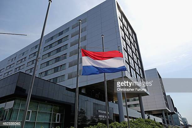 The Dutch flag flys at half mast outside The SteigenbergerHotel where relatives of the victims of Malaysia Flight MH17 are staying on July 18 2014 in...