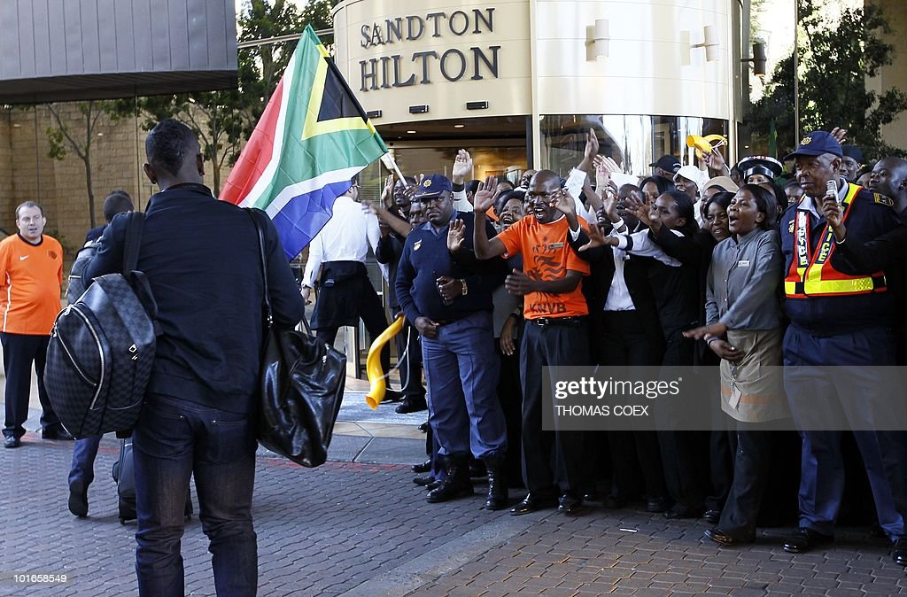 The Dutch national football team is greeted by supporters on their arrival at their hotel in Sandton, northern Johannesburg, on June 6, 2010. The Dutch face Denmark, Japan and Cameroon in the first round group stage of the South Africa 2010 World Cup.